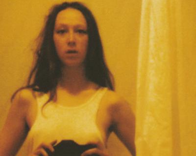 Lique Schoot, Self-portrait in Bathroom Mirror